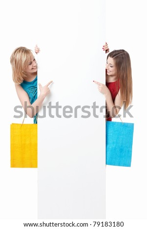 Beautiful girl with shopping bags and billboards - stock photo