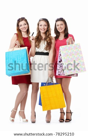 Beautiful girl with shopping bags and credit card on a white background - stock photo