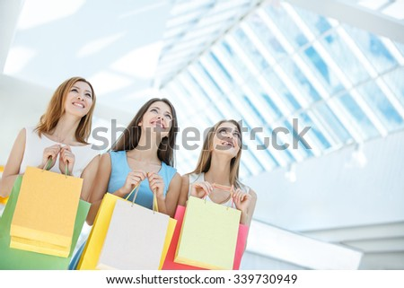 Beautiful girl with shopping bags in the store - stock photo
