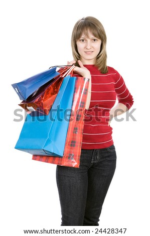 Beautiful girl with shopping bags. Isolated on white