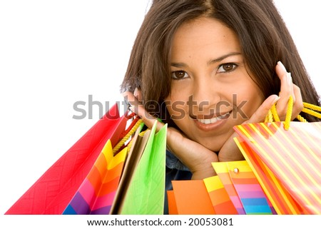 beautiful girl with shopping bags isolated over a white background - stock photo
