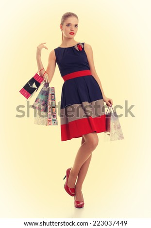 Beautiful girl with shopping bags. Pin-up style. Vintage. Retro Toning.