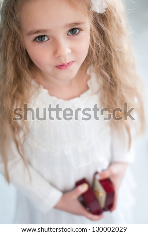 Beautiful girl with small box in hands