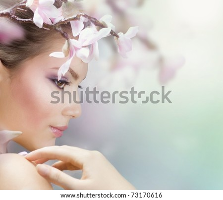 Beautiful Girl with Spring Flowers.Fresh skin - stock photo