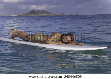 beautiful girl with stand up paddle board - stock photo