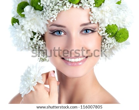Beautiful girl with stylish makeup and flowers around her.Bride - stock photo