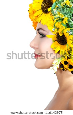 beautiful girl with stylish makeup and yellow and orange flowers around her head