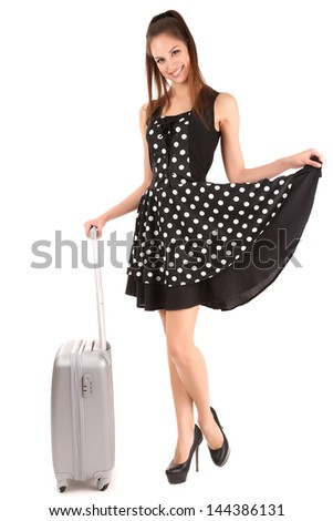 Beautiful girl with suitcase isolated on white - stock photo