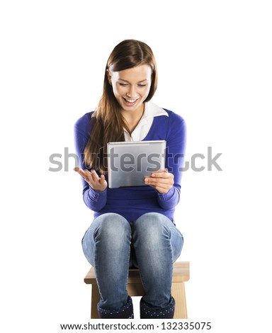 Beautiful girl with tablet is isolated on white background - stock photo