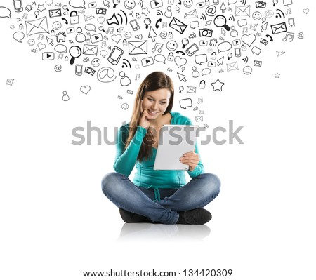 Beautiful girl with tablet is using social media - stock photo