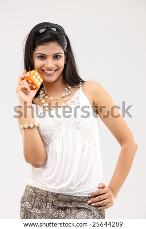 Beautiful girl with the dice - stock photo