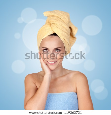 Beautiful girl with towel isolated on a over blue background and bubbles - stock photo