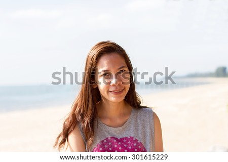 Beautiful Girl With  Travel and Vacation on The Beach enjoying