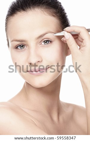 Beautiful girl with tweezers on a white background - stock photo