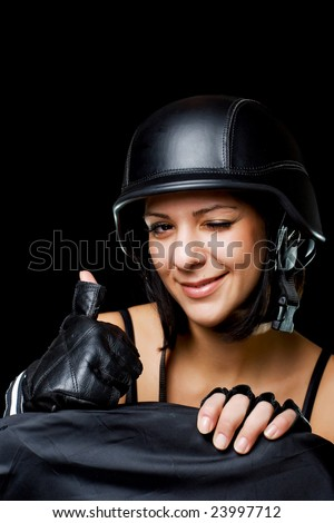 beautiful girl with US Army-style motorcycle helmet, thumbs up - stock photo
