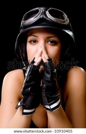 beautiful girl with US Army-style motorcycle helmet with goggles and gloves