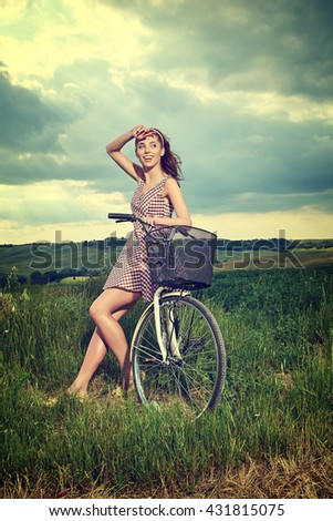 beautiful girl with vintage bike outdoor, summer Tuscany  time  - stock photo