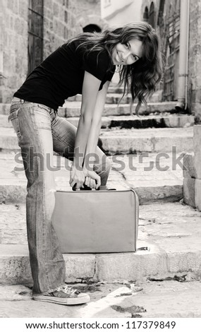 beautiful girl with vintage suitcase - stock photo