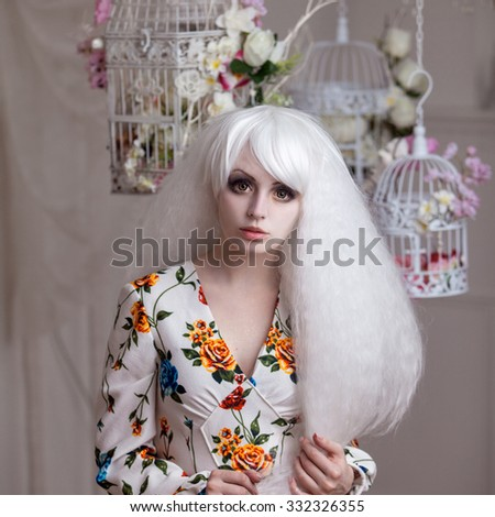Beautiful girl with white hair in  background of cells, puppet style, floral decor - stock photo