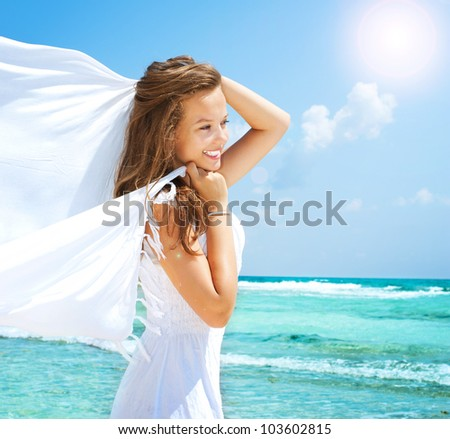 Beautiful Girl With White Scarf on The Beach. Travel and Vacation. - stock photo