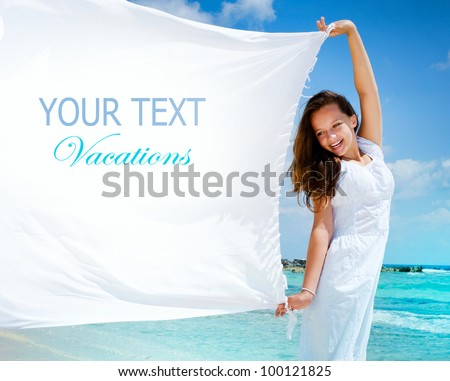 Beautiful Girl With White Scarf on The Beach. Travel and Vacation. Freedom Concept - stock photo