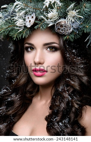 Beautiful girl with winter wreath. - stock photo