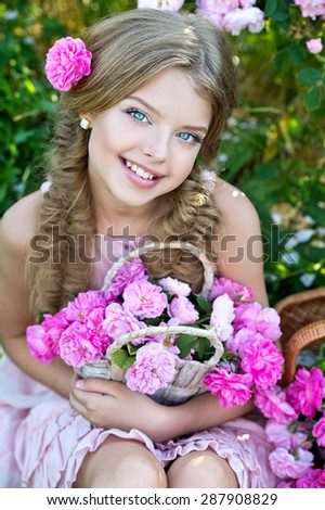 Beautiful girl with wreath of roses on nature - stock photo