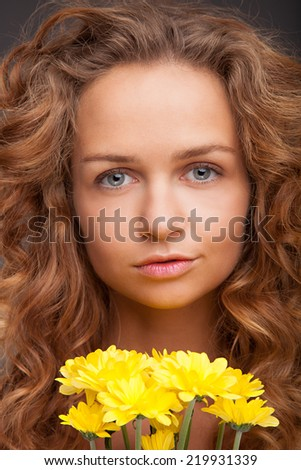 Beautiful Girl With yellow Flowers. Beauty Face - stock photo