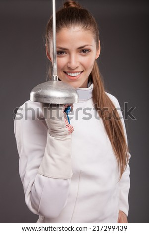beautiful girl woman with sword in fencing costume  - stock photo
