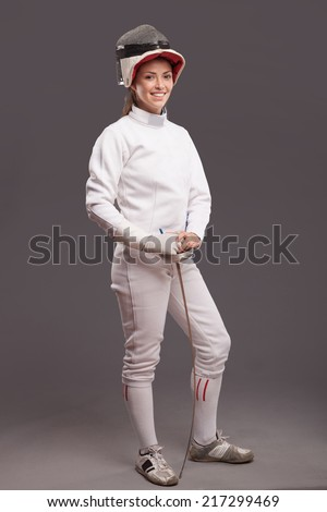 beautiful girl woman with sword in fencing costume and fencing mask - stock photo