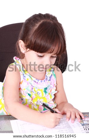 Beautiful girl working at writing desk in light background