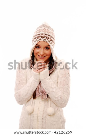 Beautiful girl wrapped up in winter clothes - stock photo