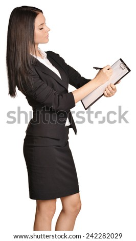 Beautiful girl writes a pen holder paper - stock photo