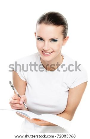 Beautiful girl writes pencil to writing-books, on white background. - stock photo