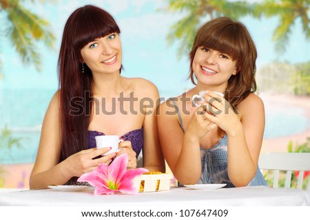Beautiful girls are resting at a resort near the sea