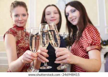 beautiful girls at a  party with glasses of champagne