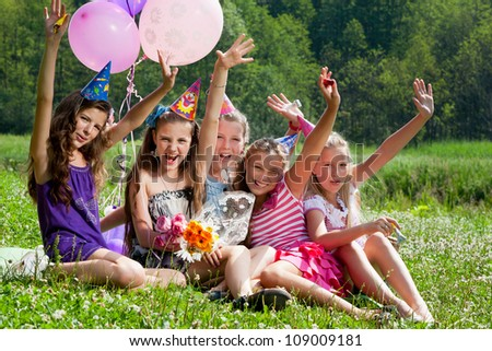 beautiful girls celebrate birthday in summer park outdoors - stock photo