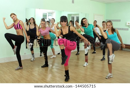 beautiful girls engaged in fitness - stock photo