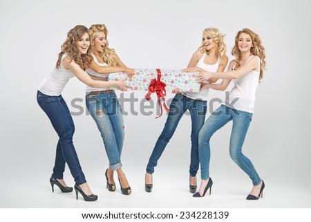 Beautiful girls holding present - stock photo
