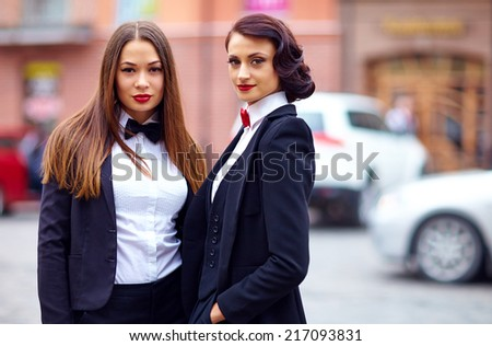 beautiful girls in black suits - stock photo