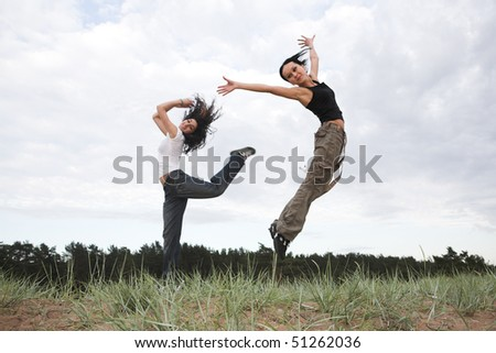 beautiful girls jumping in the park