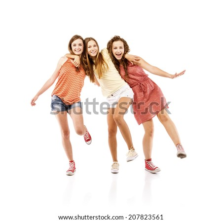 Beautiful girls laughing together, isolated on white background. Best friends - stock photo
