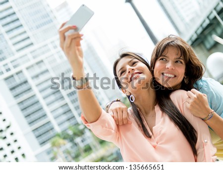 Beautiful girls posing for a photo and looking happy - stock photo