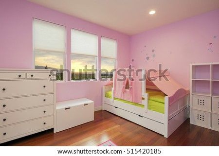 Beautiful girls room in bright pink color with furniture, wooden floor and sunset. Fancy Girls Bedroom Sets