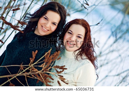 Beautiful girls twins in the forest - stock photo
