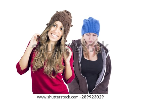 Beautiful girls wearing bonnet - stock photo