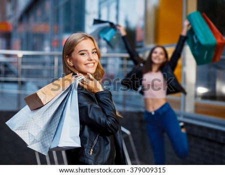 beautiful girls with shopping bags in ctiy - stock photo