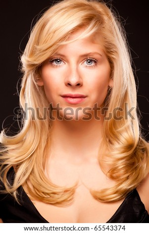 Beautiful glamour portrait of a blond girl - stock photo
