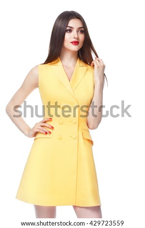 Beautiful glamour sexy woman dark brunette hair wear short yellow cotton fashion dress with button shoes heels natural beauty makeup perfect body shape casual office clothes meeting walk party date - stock photo