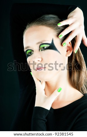 Beautiful glamour woman with stylish hairstyle and green nails.
